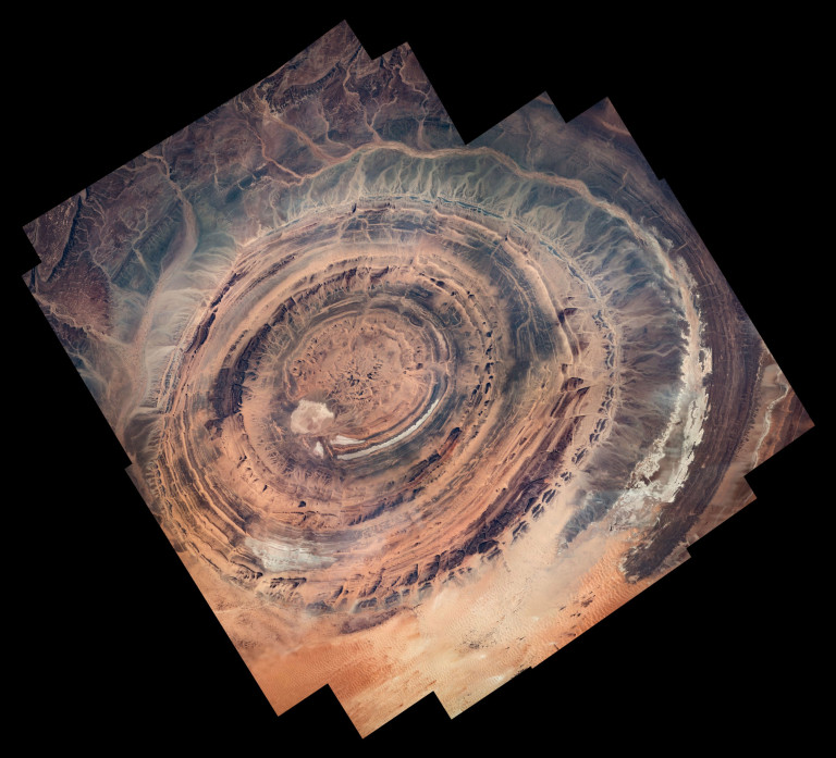 An Expedition 50 Earth observation composite of the Richat Structure, also known as the Eye of Sahara and Guelb er Richat, in the Sahara near Ouadane in west-central Mauritania, western Africa. (ESA)