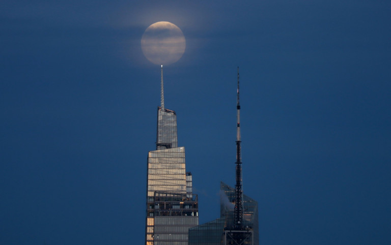 The Flower Moon rises above One Vanderbilt as the sun sets in New York City (Getty)