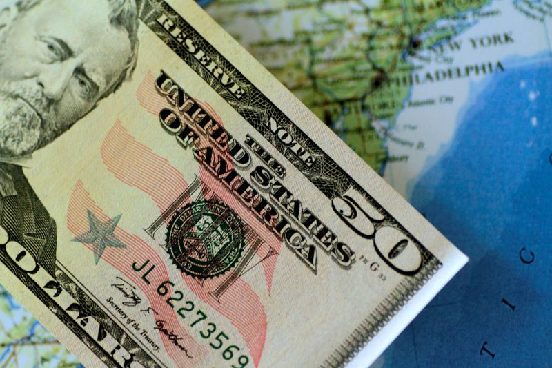 Analysis-Floundering dollar falls to bottom of global currency heap