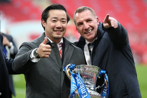 Khun Top, Chairman of Leicester City celebrates with Brendan Rodgers