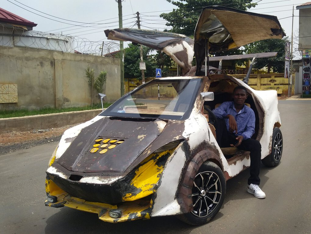Kelvin Odartei Cruickshank sits in the car he built by hand from scrap materials. He is among the tinkerers who make the most of castoff materials to build an array of wild and impressive cars.  (Patrick Lamptey Cruickshank via The New York Times)