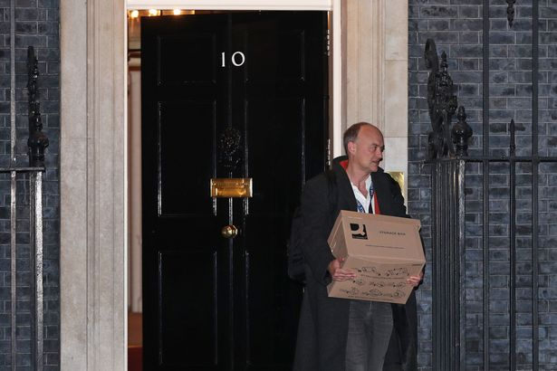 Dominic Cummings walking out of No10 with a box of paperwork last year