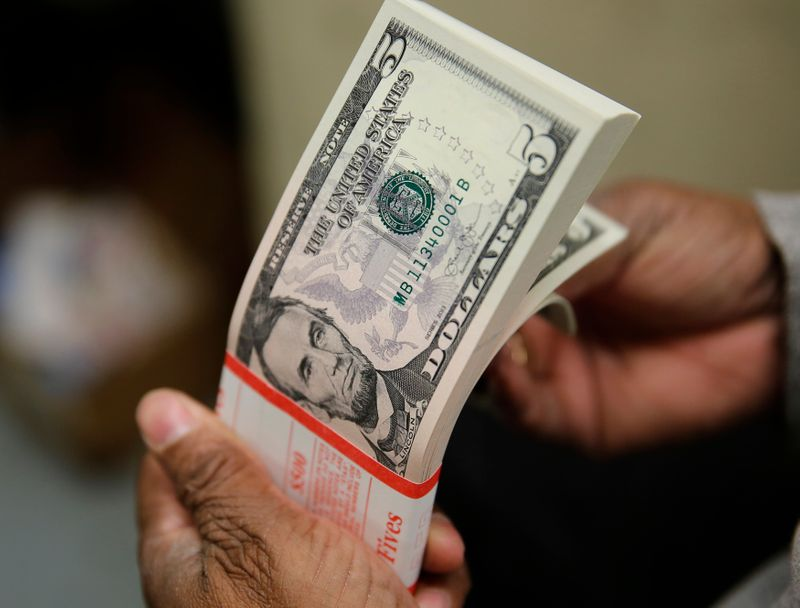 Dollar holds gains on inflation, kiwi boosted by reopening