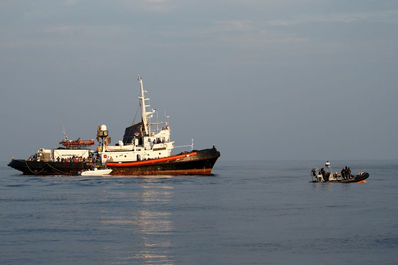 Four boats carrying hundred of migrants land in Italy's Lampedusa - report