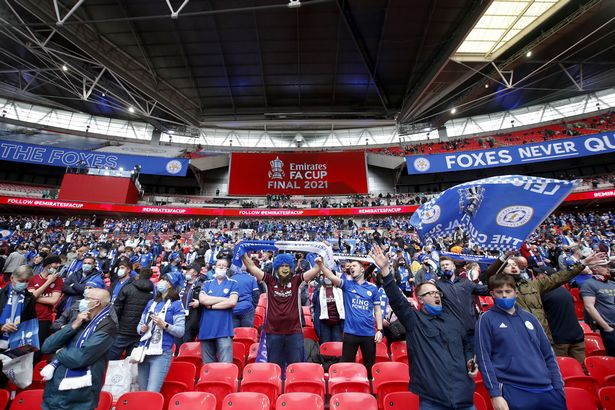 Leicester City fans cheer on their side in the stands at Wembley