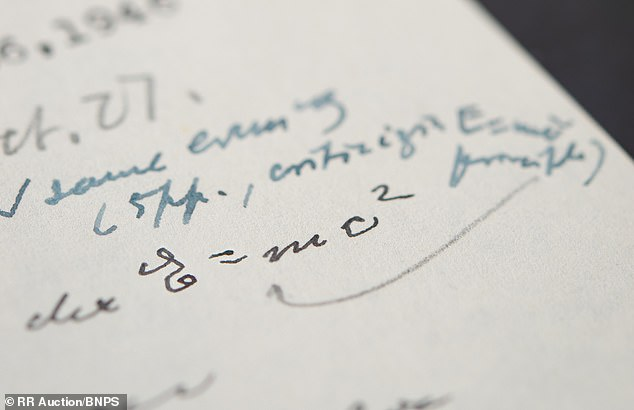 A letter penned by Albert Einstein which is rare for containing his famous 'E = mc²' mass–energy equivalence formula (pictured) sold at auction for $1.2 million, more than three times what was expected
