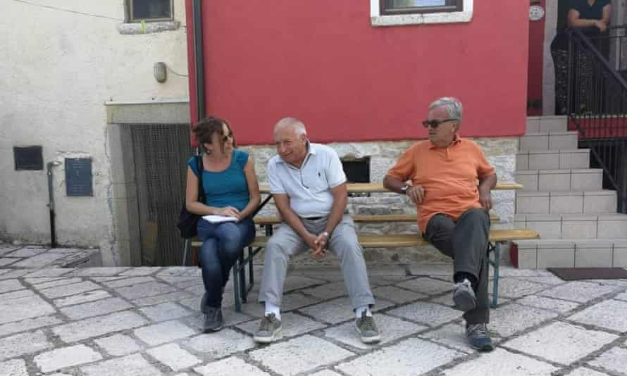 Guardian reporter Angela Giuffrida talking to residents of a small town in the Molise region of Italy.