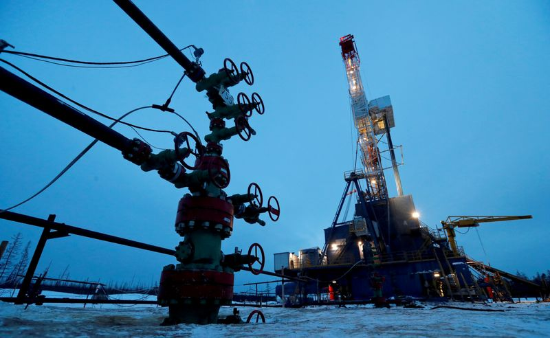 Oil climbs on drop in U.S. oil stockpiles, solid demand outlook