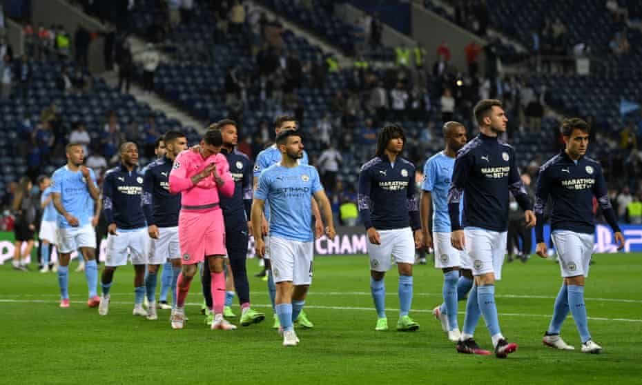Manchester City's players get ready to collect their unwanted silver medals.