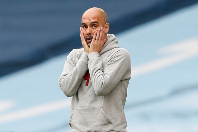 Manchester City's Spanish manager Pep Guardiola gestures on the touchline during the English Premier League football match between Manchester City and Chelsea at the Etihad Stadium in Manchester, north west England, on May 8, 2021.