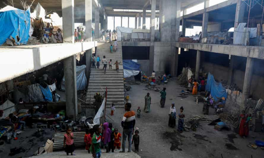 Displaced people who have taken refuge in a building under construction at Aksum University, in Shire, Tigray. Of 3 million people targeted to receive aid, only 347,000 have recieved it, the UN said.