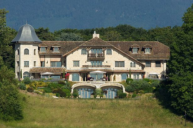 The enormous residence is on the banks of Lake Geneva