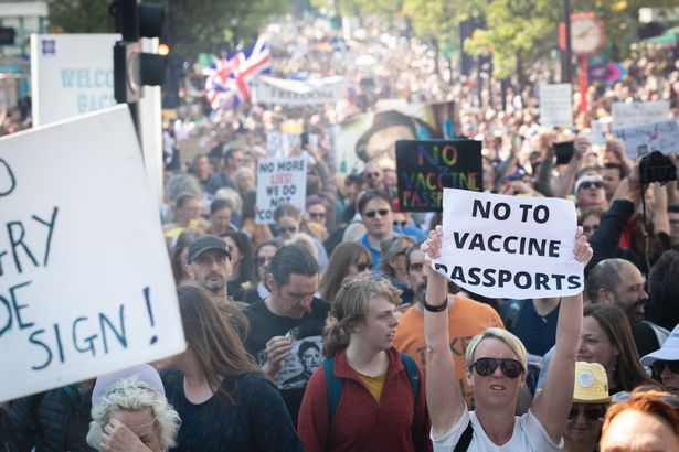 Thousands of protesters against proposed Covid-19 health passports march down Oxford Street in London