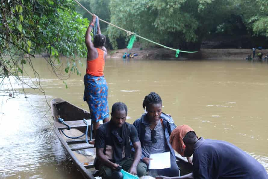 A conservation team collects environmental DNA from the Dubo River, Liberia. This method of sampling is much quicker than traditional surveying techniques.