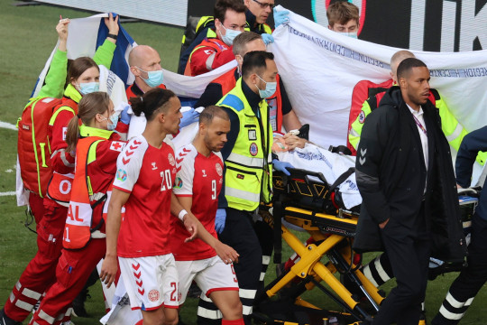 Paramedics using a stretcher to take out of the pitch Denmark's Christian Eriksen after he collapsed during the Euro 2020 soccer championship group B match between Denmark and Finland at Parken stadium