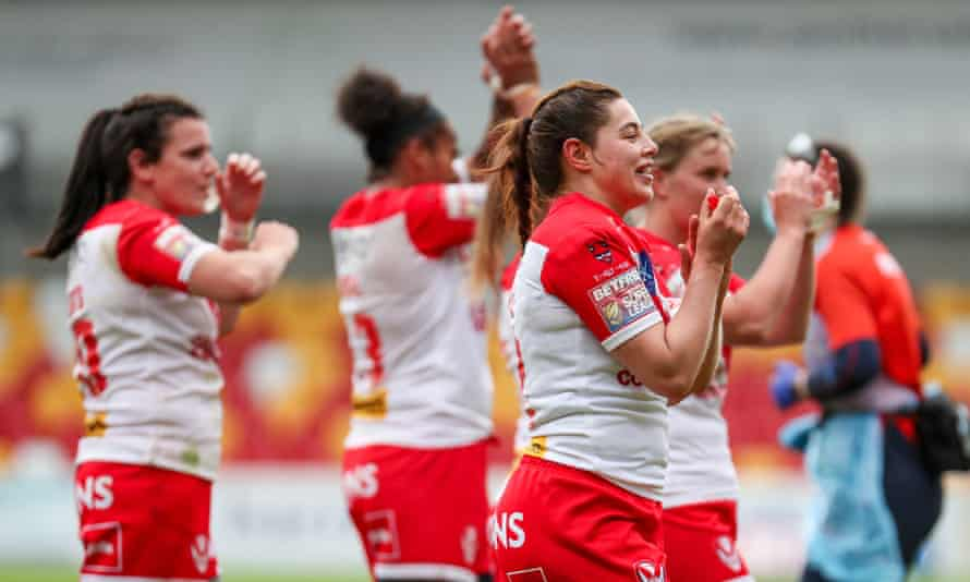 St Helens' Emily Rudge (right of centre) says: 'We were playing in parks and nobody was watching. Now, we've got Super League stadiums, we're affiliated with Super League teams.'