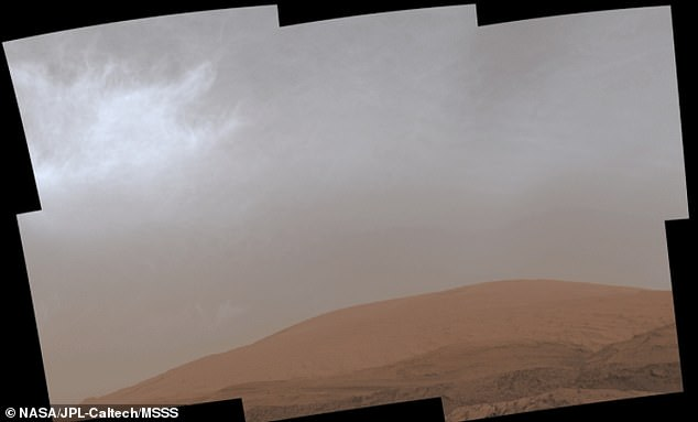 This images shows clouds over Mount Sharp on March 19, 2021, the 3,063rd Martian day