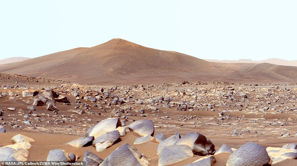These achievements include recording sounds on Mars, making oxygen using carbon dioxide in the atmosphere and sending back more than 75,000 pictures of the Martian world. This image shows 'Santa Cruz' hill, which Perseverance took standing 1.5 miles away using its powerful cameras