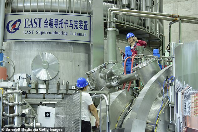 Workers are pictured checking the equipment at the EAST inChina's eastern Anhui province