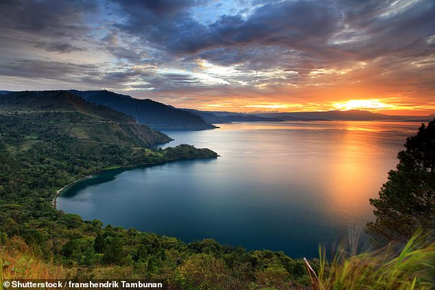 One of the Earth's largest-ever explosions, Toba is believed to have erupted some 5,097 square miles of material and triggered a 6–10 year volcanic winter. Pictured: Lake Toba, which fills the cauldron-like hollow, or caldera, left behind by the eruption, as seen in the present