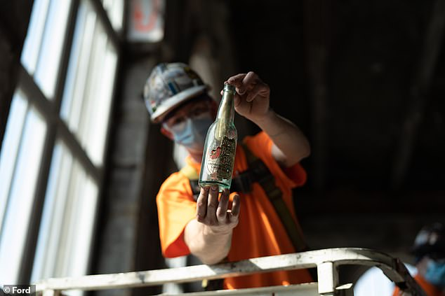 Foreman Leo Kimble and labourer Lukas Nielsen of plaster contractor Homrich found the pre-Prohibition-era bottle (pictured) in the station's tea room on May 4 this year