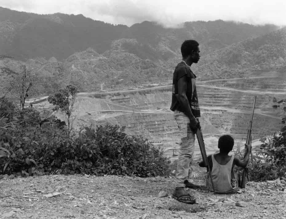 Bougainville Revolutionary Army fighters keep watch over the captured Panguna mine in 1994