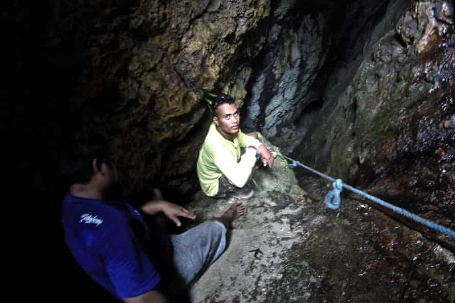 Two men in sacred underground caves