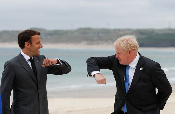 Boris Johnson and Emmanuel Macron elbow bump as they arrive for the G7 summit in Carbis Bay