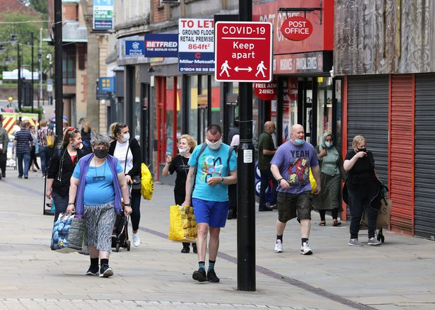 Residents in Bolton town centre, in Greater Manchester, as the region tries to cope with the rise of the new Delta Indian variant of Covid