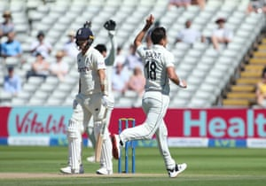 New Zealand's Trent Boult celebrates with teammates after taking the wicket of England's Olly Stone