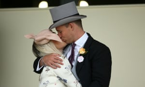 A couple kiss during day four of Royal Ascot.