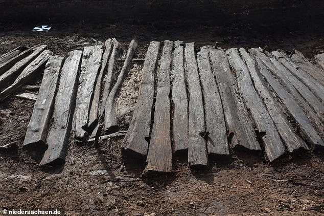 The road is merely a collection of weathered wooden boards, but were originally laid across the marshland for people to safely pass. Remains of broken carriage axel was also pulled from the bog, which researchers say may solve how the owner lost their shoe thousands of years ago