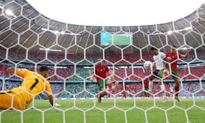Raphael Guerreiro of Portugal (centre) scores an own goal for Germany's second goal.