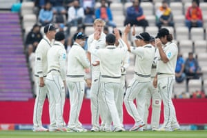 New Zealand celebrate the wicket of the Indian captain.