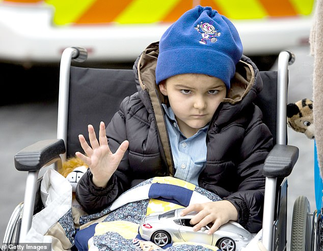 Proton beam therapy — which saved the life of toddler Ashya King in 2014 after his parents won a High Court case to have his treatment in Prague (pictured) — can now be used to treat thousands of patients in Britain, a report released today suggested