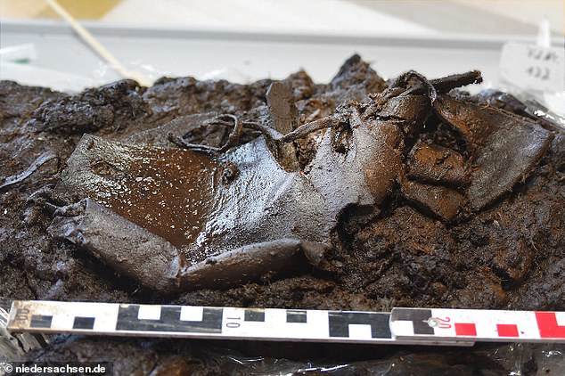 A leather shoe that was lost in a bog for 2,000 years ago has been found by archaeologists who believe it may have slipped off the owner's foot when they accidently stepping in the mud