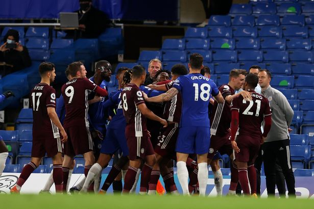 Players of Leicester City and Chelsea clash during the Premier League match