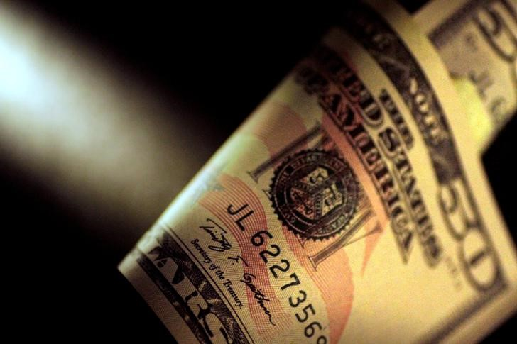 Dollar Down Near One-Month Low Ahead of RBA Policy Decision