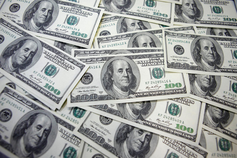Dollar Edges Higher; Weekly Losses Likely on Dovish Fed