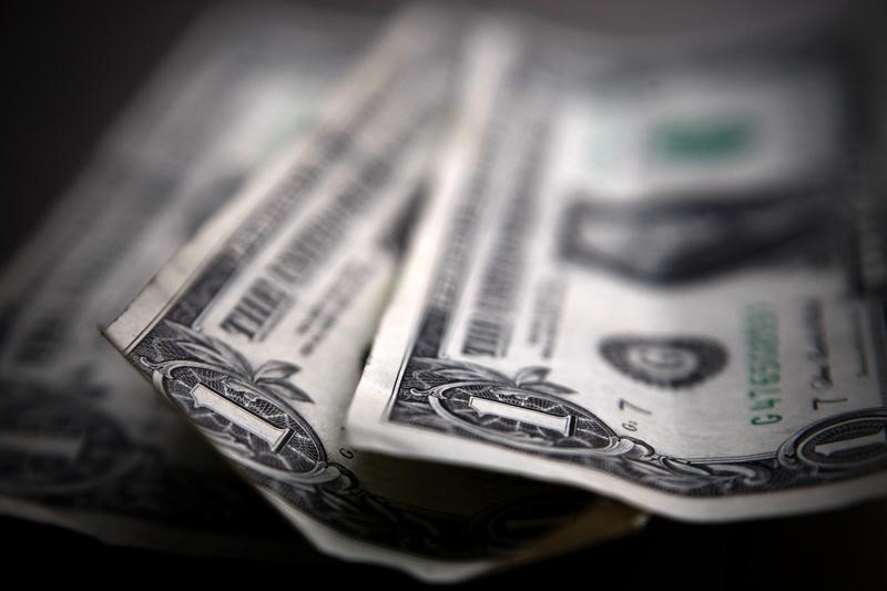Dollar Down, Investors Digest Data and Wait for Fed Taper Clues