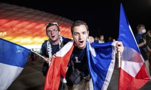French fans celebrate outside the Allianz Arena.