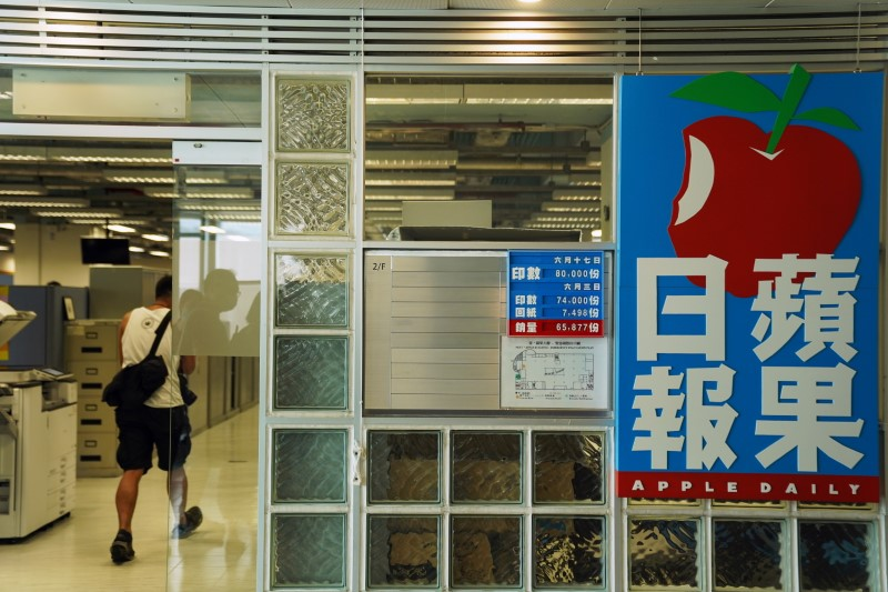 HK pro-democracy tabloid Apple Daily increases production after police raid