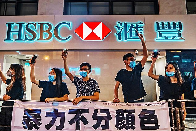 Protesters stage a demonstration outside an HSC branch in Hong Kongin 2019. TheLondon-headquartered lender now makes the vast majority of its profits in Asia