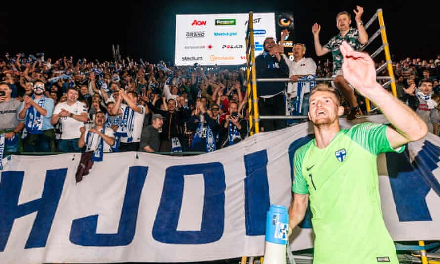 Lukas Hradecky leads the fans' celebrations after Finland beat Hungary in the Nations League.