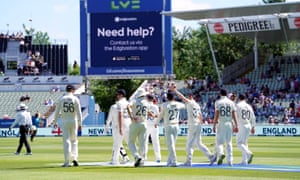 England players come out to field during day four