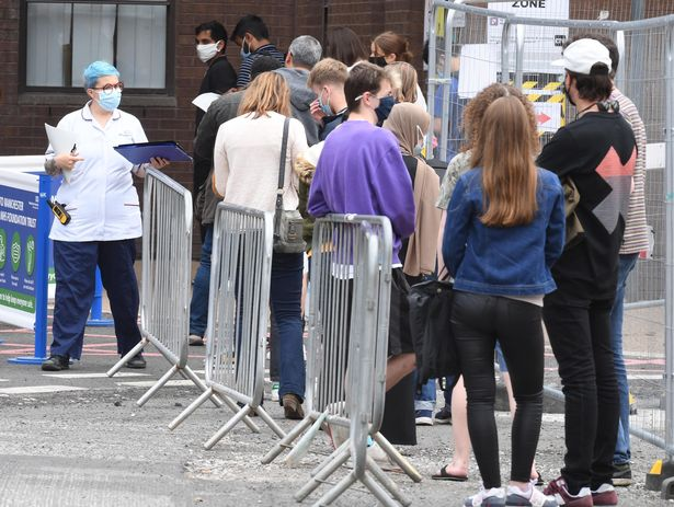 Students and adults gather at Manchester Royal infirmary