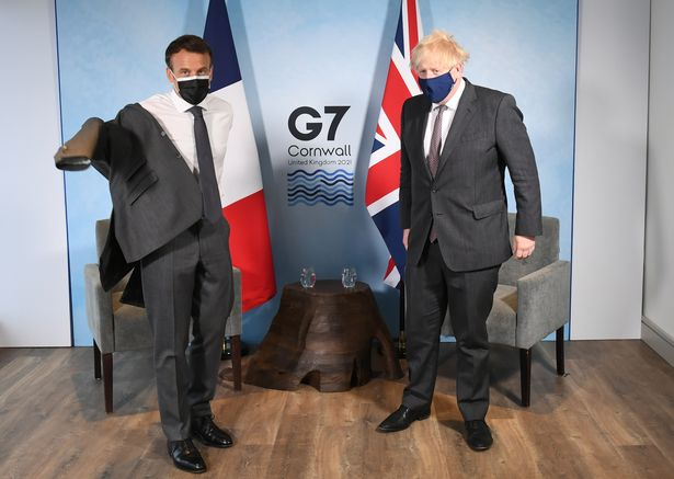 Boris Johnson with Emmanuel Macron ahead of their meeting at the G7 summit yesterday
