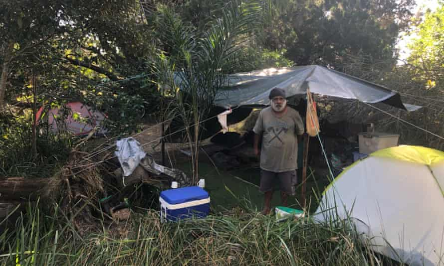David Clark outside his tent on 30 July 2021. He is one of more than 30 campers living in Byron Bay's hinterland because they can no longer find affordable accommodation in the town.