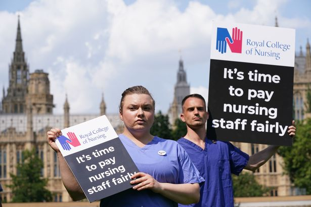 Nurses outside the Royal College of Nursing in London make their feelings clear following the Government's announcement