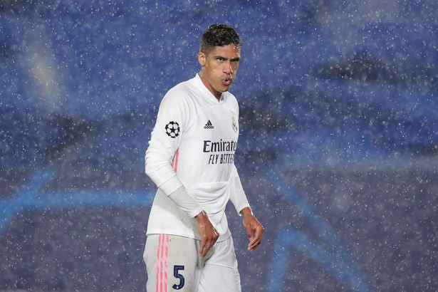 MADRID, SPAIN - APRIL 27: MADRID, SPAIN - APRIL 27: Raphael Varane of Real Madrid CF reacts during the UEFA Champions League Semi Final First Leg match between Real Madrid and Chelsea FC at Estadio Alfredo Di Stefano on April 27, 2021 in Madrid, Spain. Sporting stadiums around Spain remain under strict restrictions due to the Coronavirus Pandemic as Government social distancing laws prohibit fans inside venues resulting in games being played behind closed doors. (Photo by Gonzalo Arroyo - UEFA/UEFA via Getty Images)